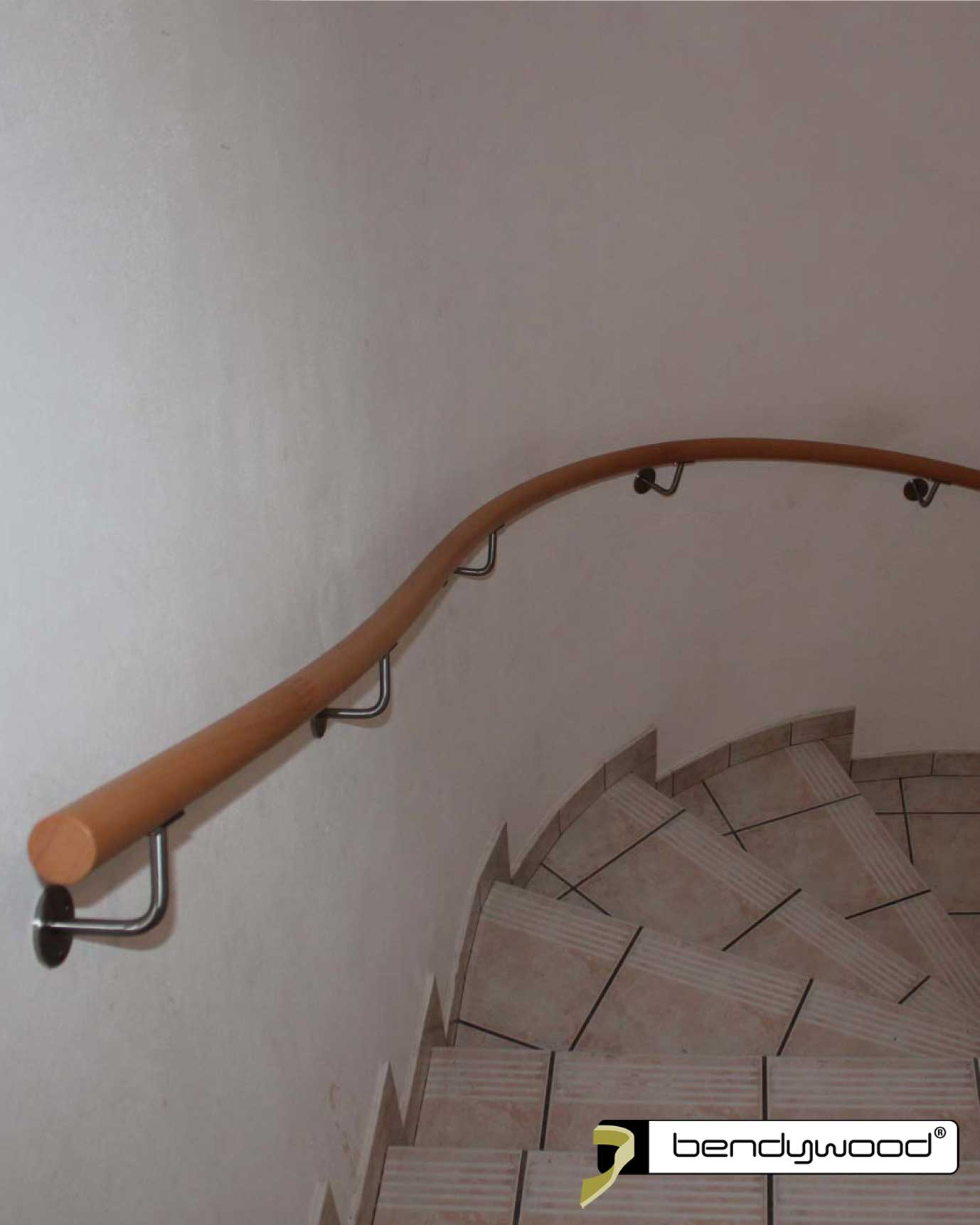 Round bending handrails in Bendywood®-beech for staircase with irregular bending radius
