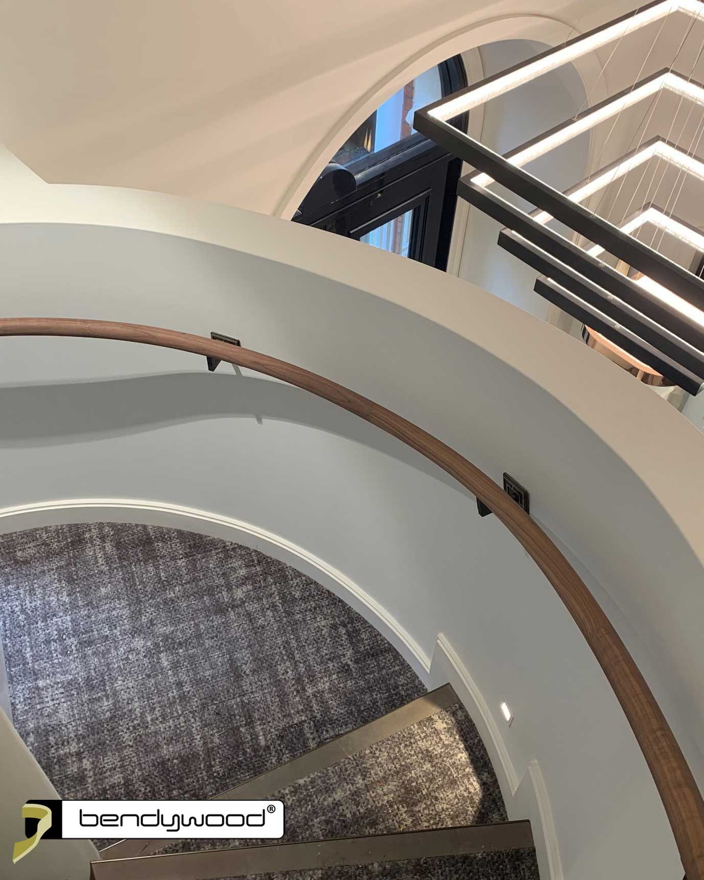 Bending handrails ø40mm in Bendywood® American walnut for curved staircase