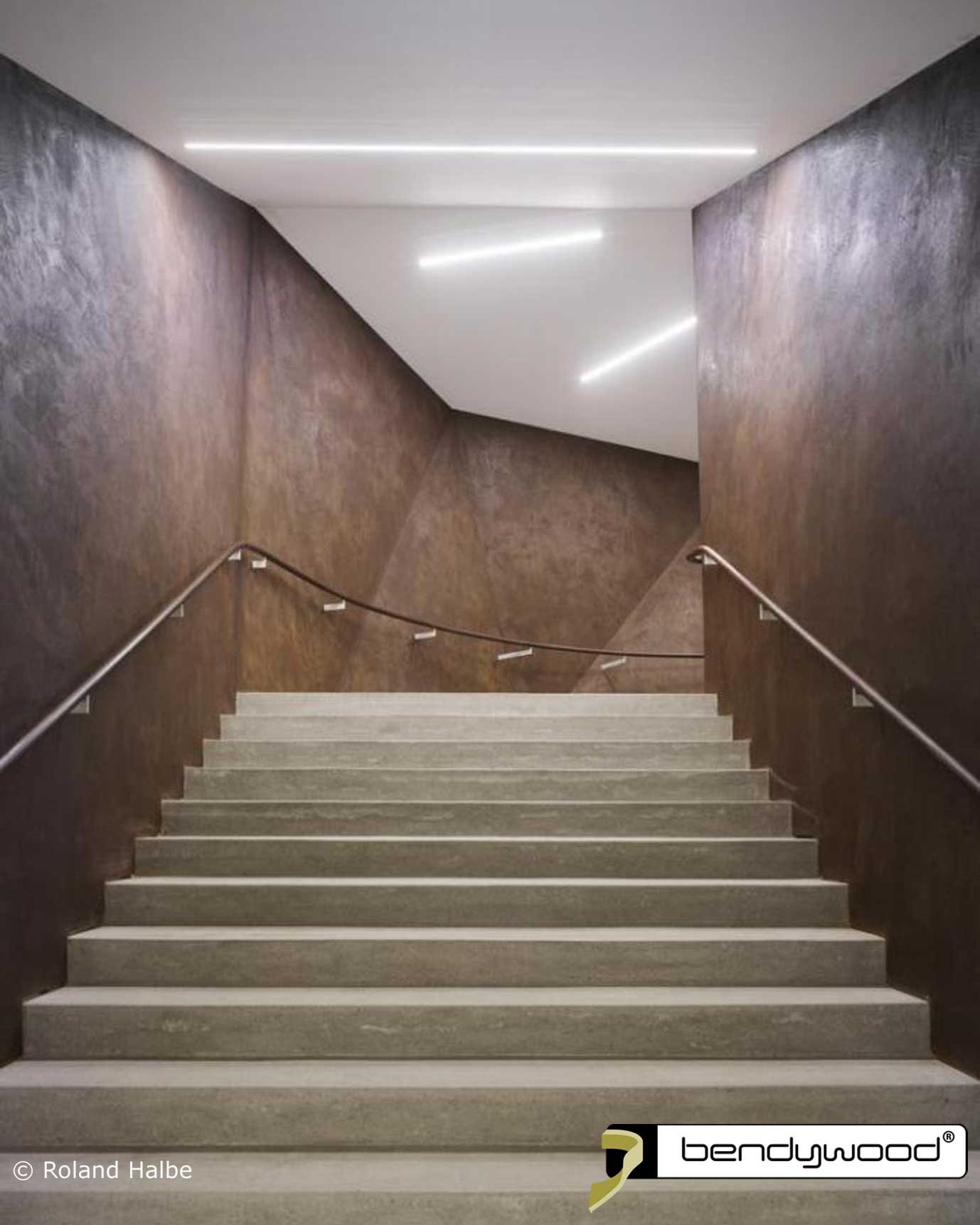 Stairs new concert hall Andermatt, Switzerland. Curved inner and outer handrails in Bendywood® oak.