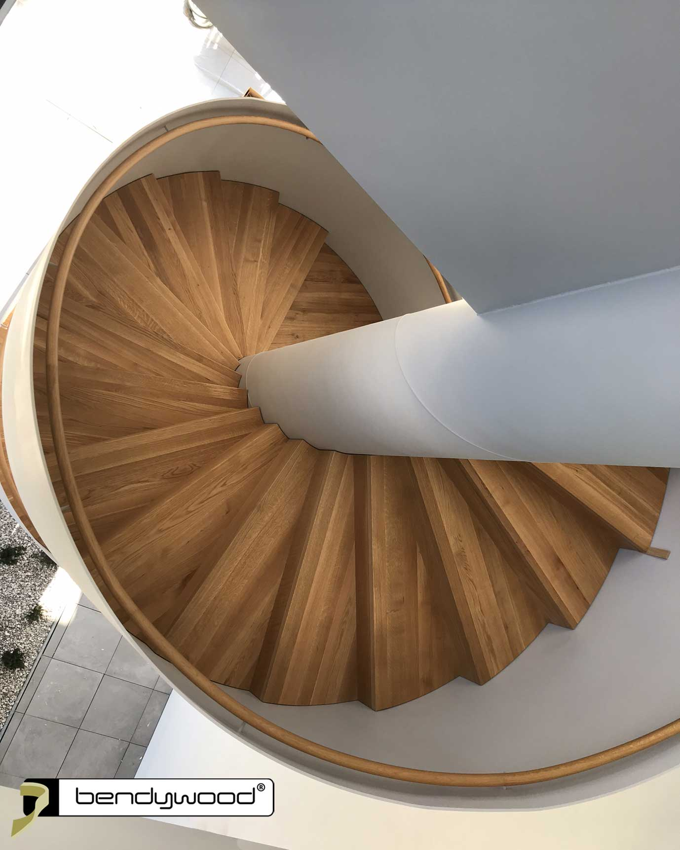 Modern designed spiral staircase with steel plate stair railing and handrail in Bendywood®-oak